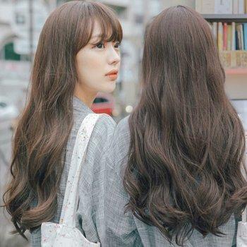 今年流行烫什么样的发型 齐头帘长发烫发发型图片