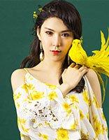 侯伊荻刘海编发拍公益写真 明星示范美腻时尚的编发发型