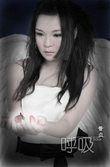 今被杨幂赏识而爆红 歌手董贞的古典发型秀起