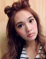 女星杨丞琳晒出丸子头造型 发色美颜惹人爱