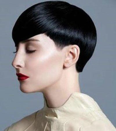 这款女生不对称剪裁时尚沙宣头短发,简短利落的剪裁发式造型美感十足图片