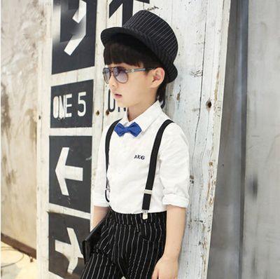 这款清新的西瓜头发型搭配上白色衬衣条纹背带裤以及黑色的礼帽完美的图片