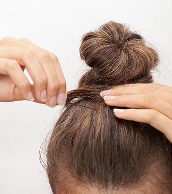 及腰长直发的扎法 中发直发扎法丸子头(2)图片