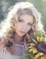 脸型长的女生适合什么样的卷发 适合中年长脸女性的卷发造型
