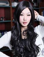 中年妇女大波浪烫发发型 中年女士黑色长波浪发型图片