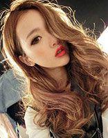 30岁女性的中长发发型 时尚波浪中长卷发发型图片
