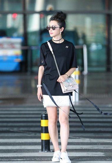 女艺人李冰冰梳蓬松丸子头 炫出简约时尚风的清爽造型