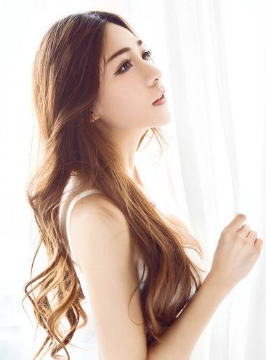 三十岁的女人适合烫什么头 30岁长发发尾烫头图片
